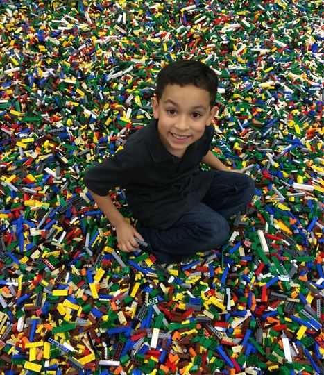 Kid in Lego pile