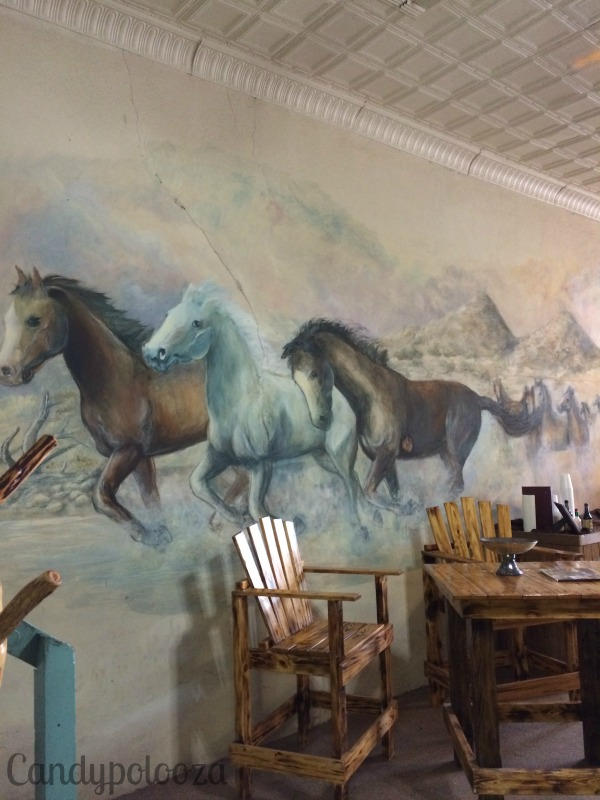 JL Mercer horses on the wall