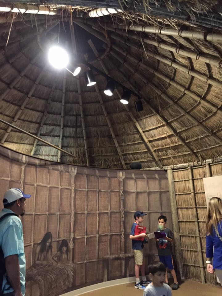 The exhibits are truly exceptional! Inside of a straw hut.